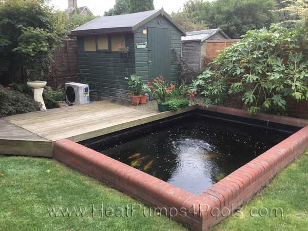 Koi pond heating with a heat pump for Koi holding pool