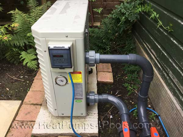 Koi pond heating with a heat pump for Koi pond swimming pool pump